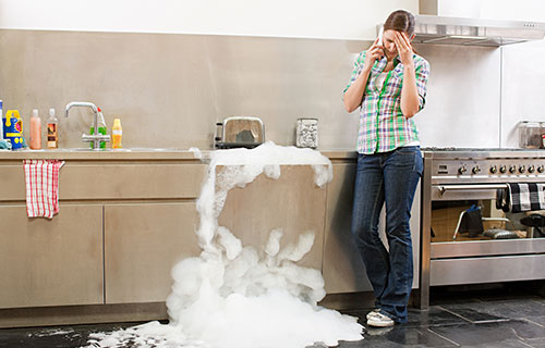 water damage in progress as dishwasher overflows